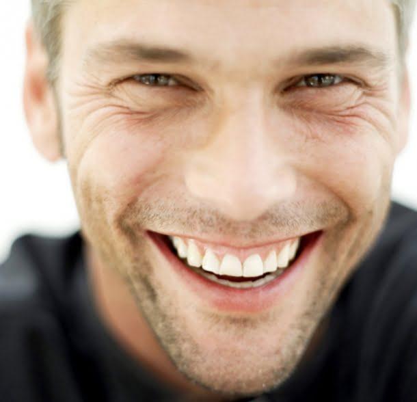 man-smiling-in-black-shirt